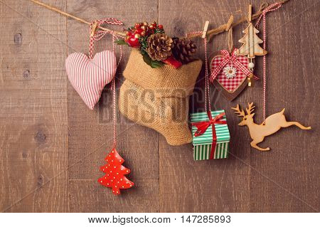 Rustic Christmas decorations hanging over wooden background