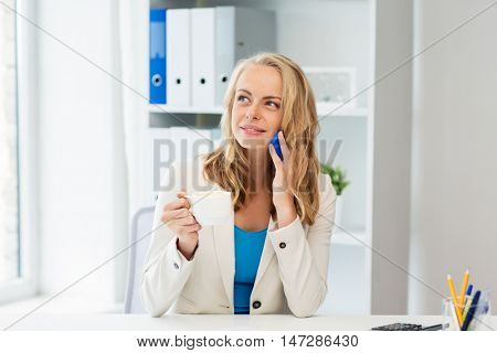 business, tecnology, communication and people concept - happy businesswoman calling on smartphone at office