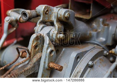 industry, machinery and technology concept - close up of vintage car hoist mechanism