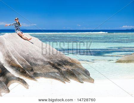 Woman Sitting On Top Of Granite Rock