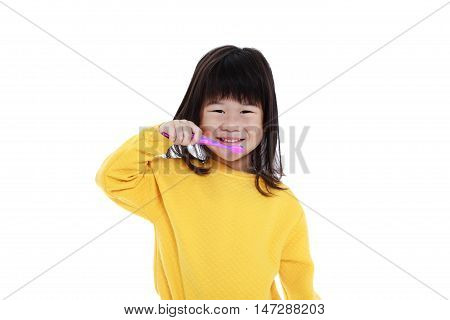 Closeup Cute Asian Girl With A Toothbrush In Hand Going To Brush Teeth. Isolated On White.