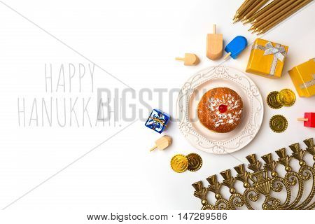 Hanukkah holiday objects on white background. View from above