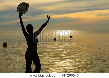 Women body sexy silhouette with bikini on Thung Wua Lan Beach at Chumphon Province Thailand.