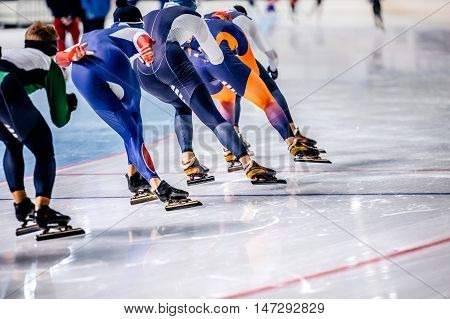 group of men skating on ice sports arena. warm-up before competitions in speed skating