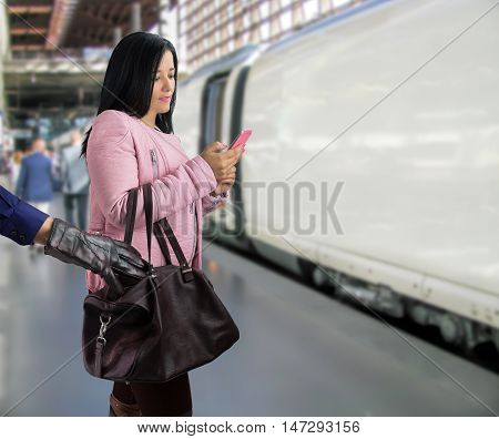 criminal stealing at the train station to a wandering traveler