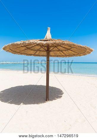 Sunshade Umbrellas on the beach at summer day