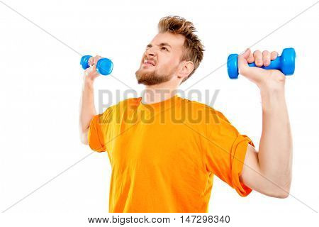 Laughing young man with dumbbells. Sports, healthy lifestyle. Isolated over white.