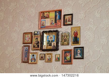 Orthodox Christian Icons On The Wall, Glued Wallpaper.