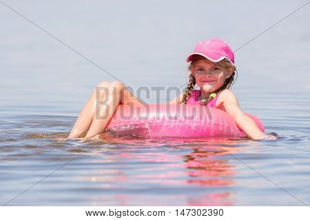 The Girl In The Cap Swim In The River Sat On The Lap Swimming And Looked Into The Frame