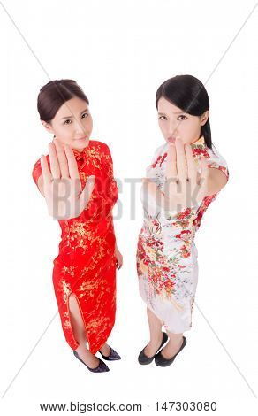 two Chinese woman say no with gesture in traditional cheongsam in the new year