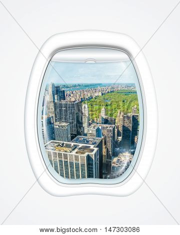 Aereal view of New York skyline and Central Park on board of a plane through the porthole window. copy space