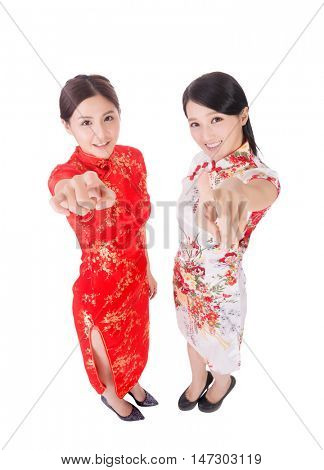 gesture of Chinese woman in traditional cheongsam in the new year