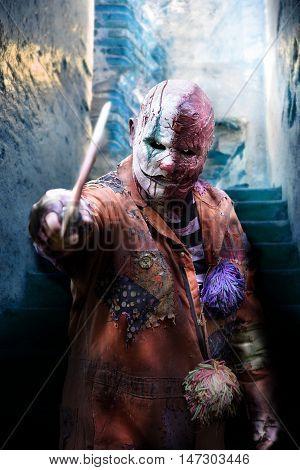 psychopath killer clown  in horror house on halloween
