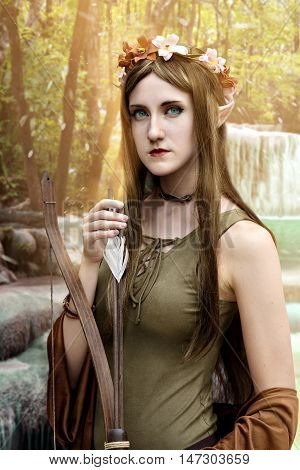 beautiful elf woman hunting in enchanted forest