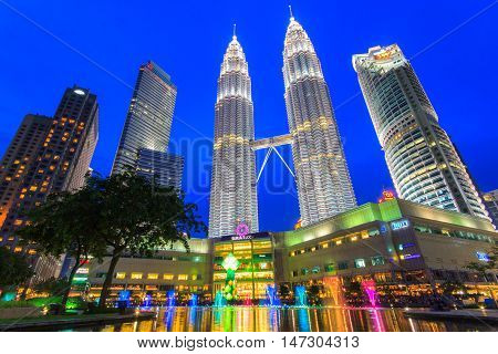 KUALA LUMPUR MALAYSIA - JUNE 18 2016 : Petronas Towers on April 08 2014 in Kuala Lumpur Malaysia.Petronas Towersalso known as Menara Petronas is the tallest buildings in the world from 1998 to 2004