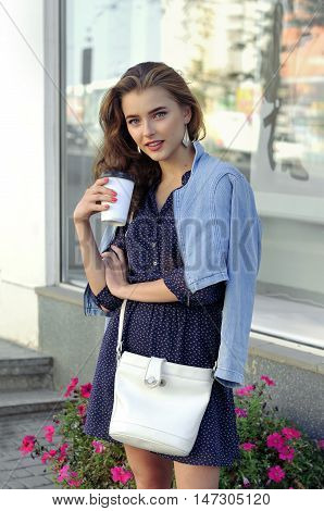 Girl Drinks Coffee From A Paper Cup