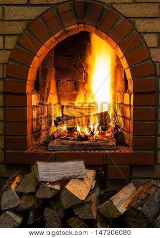 Pile Of Wood And Logs Burning In Fireplace