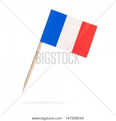 Miniature paper flag France. Isolated French flag pointer on white background. With shadow below