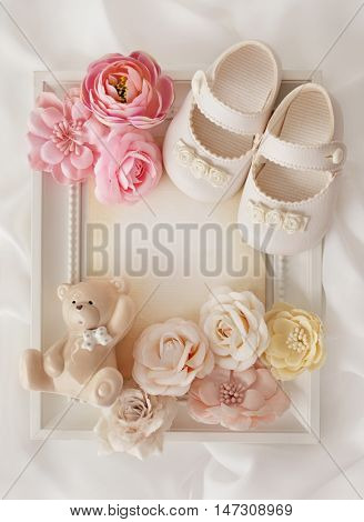 baby shower frame background - baby shoes and flowers
