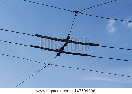 Horizontal photo of electric junction lines of trolley buses in Bucharest