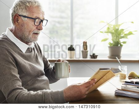 Reading Relaxation Pension Grandfather Coffee Concept