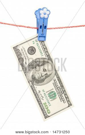 One hundred dollar on clothesline