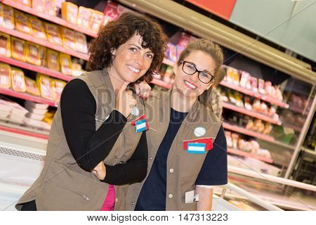 Portrait Of Two Woman Shop Assistants In A Supermarket
