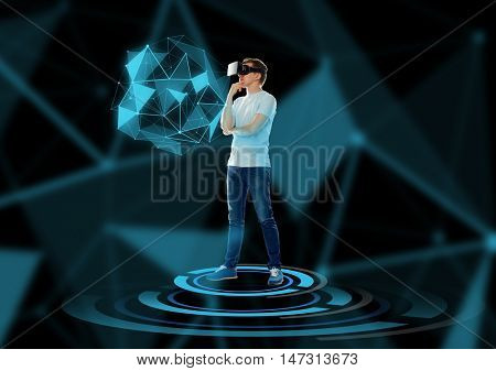 3d technology, augmented reality, gaming, cyberspace and people concept - happy young man with virtual reality headset or 3d glasses thinking and looking at low poly shape hologram