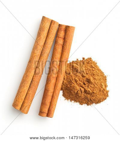 Cinnamon sticks and ground cinnamon isolated on white background. Top view.
