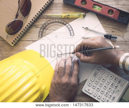 Hands Of Architect Drawing Construction Plan