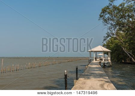 A footpath along by the sea with clear sky.