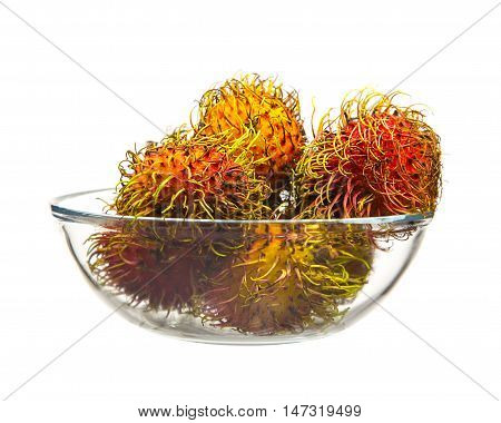 Rambutan sweet delicious fruit in glass cup on white background.