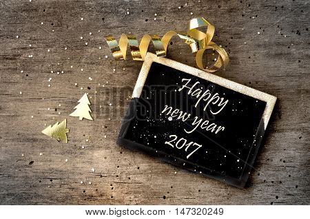 little sign with message happy new year written sign on wooden background