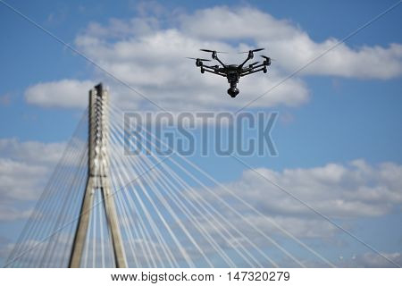 Copter flight against the blue sky. RC aerial drone.