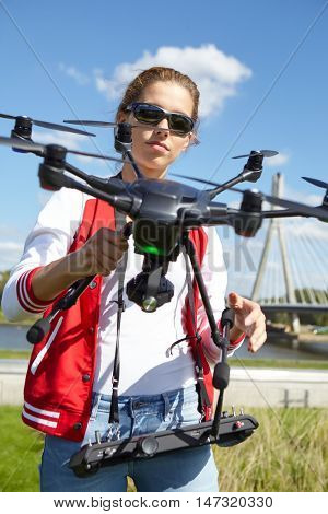 woman holding  drone uav over a field. Aerial video and photography maker.