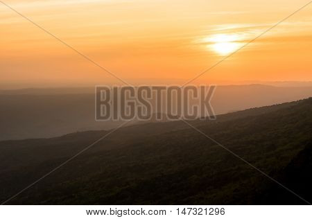 sunrise over black forest hill with morning mist.