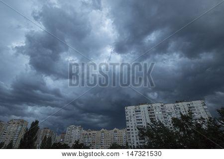 Heavy overcast sky above the evening Kyiv