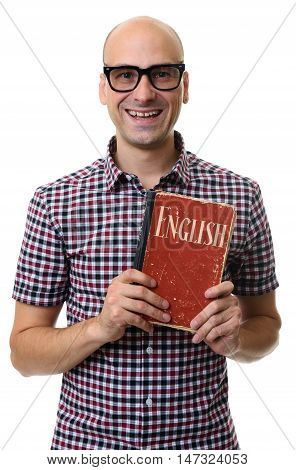 smiling man holding textbook isolated on white background. english learning concept