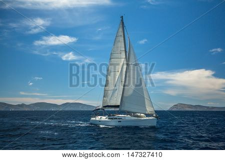 Yacht sailing of the coast of Greece.