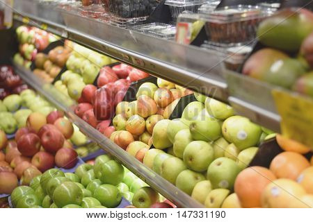 Fresh organic fruits and produce on a supermarket shelf