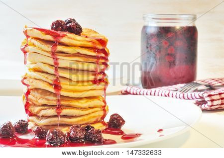 Pile Of Pancakes With Cherry Jam In White  Plate On The  Table