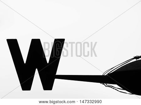 Monochrome image of an Old weathervane pointing West