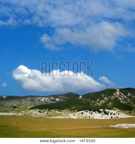 Dinara Mountain Over Blue Sky 7