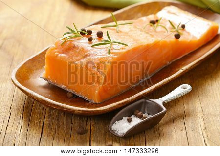 salty salmon red fish with black pepper and rosemary