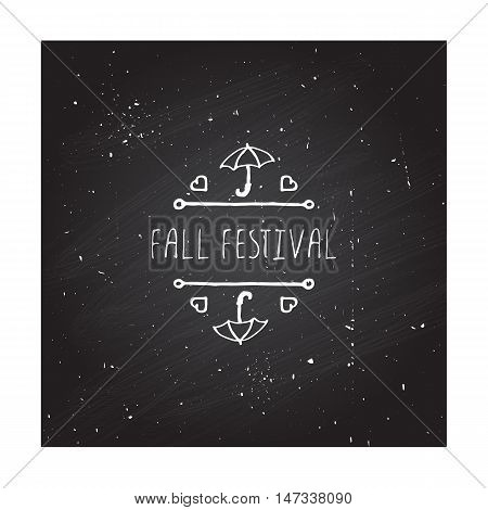 Hand-sketched typographic element with umbrella, hearts and text on chalkboard background. Fall festival