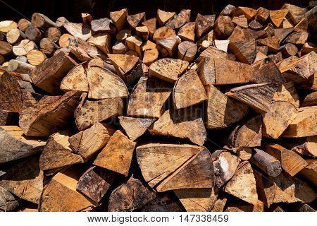 A pile of firewood. Wood texture background