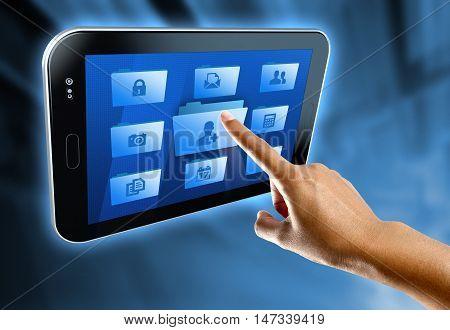 A woman's finger select a folder on a digital tablet
