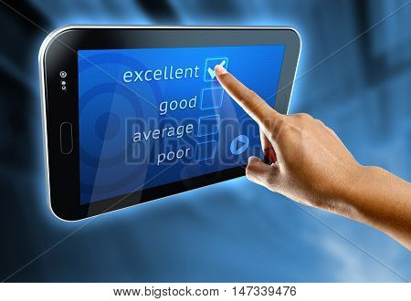 A woman's finger answer a online survey on a digital tablet