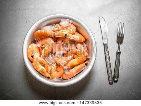 Jumbo shrimp with ice. On the metal table.