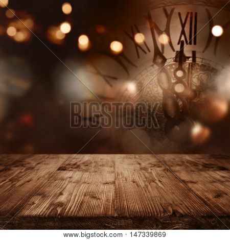 New year background with a clock in front of a table